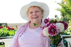 Senior Woman with Flowers Stock Image