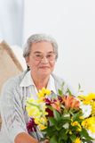 Senior woman with flowers Royalty Free Stock Photography