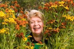 Senior woman with flowers Stock Photos