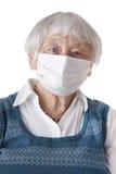 Senior woman with flu mask royalty free stock photo