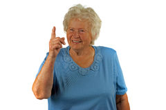 Senior woman with forefinger up Stock Photos