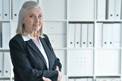 Senior woman in formalwear smiling. At camera Royalty Free Stock Photography