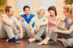 Senior woman and friends talking with each other Stock Image