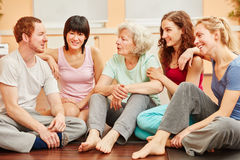 Senior woman and friends in yoga class break Stock Photos