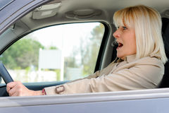 Senior woman frightened At the Wheel Royalty Free Stock Image