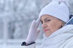 Senior woman in frosty winter Stock Photos