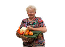 Senior woman with a fruit basket Royalty Free Stock Images