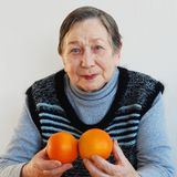Senior woman with fruits Royalty Free Stock Images