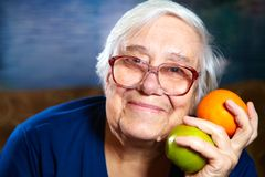 Senior woman with fruits Stock Photography