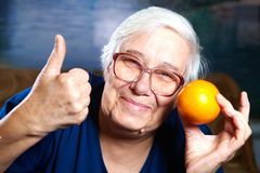 Senior woman with fruits Royalty Free Stock Photography