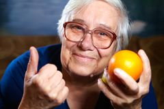 Senior woman with fruits Royalty Free Stock Photos