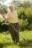 Senior woman in the garden Stock Image