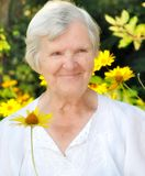 Senior woman in garden. Royalty Free Stock Images