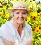 Senior woman in garden. Royalty Free Stock Image
