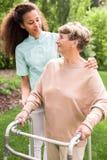 Senior woman in the garden Stock Photos