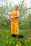 Senior  woman gardener  cut grass Stock Photo