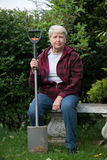 Senior  woman gardening. Senior woman gardening, sitting with spade Stock Images
