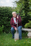 Senior  woman gardening. Senior woman gardening, sitting with spade Stock Photography