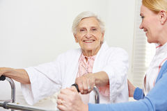 Senior woman with geriatric nurse Stock Photos