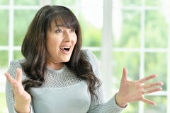 Senior woman gestures Stock Image