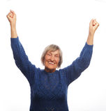 Senior woman gesturing victory over white background Stock Images