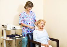 Senior Woman Gets Ultrasound Royalty Free Stock Photo