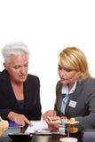 Senior woman getting financial Stock Image