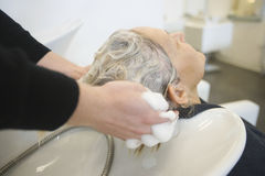 Senior Woman Getting Hair Washed In Parlor Royalty Free Stock Photos