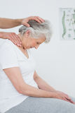 Senior woman getting the neck adjustment done Royalty Free Stock Image