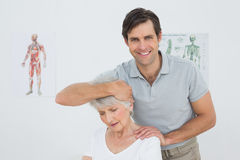 Senior woman getting the neck adjustment done Royalty Free Stock Images
