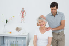 Senior woman getting the neck adjustment done Stock Photography