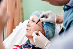 Senior woman getting skin care injection Stock Photo