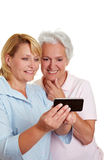 Senior woman getting smartphone Stock Images