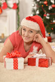 Senior woman with   gifts Royalty Free Stock Photos
