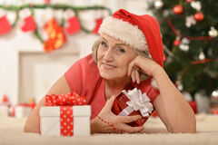 Senior woman with   gifts Stock Images