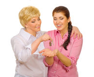 Senior woman give keys to her daughter Royalty Free Stock Photo