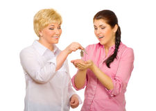 Senior woman give keys to young woman Stock Images