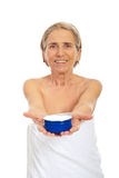 Senior woman gives container with cream Royalty Free Stock Photo