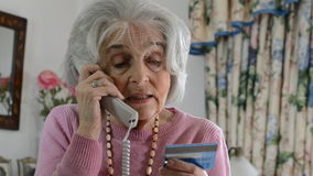 Senior Woman Giving Credit Card Details On The Phone stock video