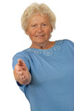 Senior woman giving hand for handshake Stock Image