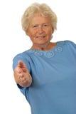Senior woman giving hand for handshake Stock Image