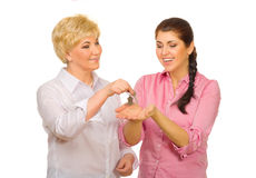 Senior woman giving keys to her daughter Royalty Free Stock Photo