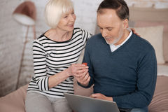 Senior woman giving some remedy to man Stock Images
