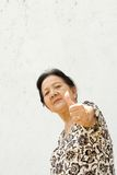 Senior woman giving thumb up royalty free stock photo