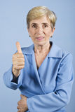 Senior woman giving thumbs up Royalty Free Stock Images