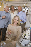 Senior Woman With Glass Of Champagne Royalty Free Stock Images