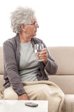 Senior woman glass of water Royalty Free Stock Image