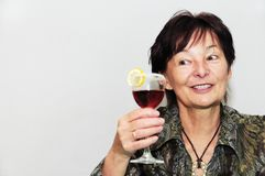 Senior woman with glass of wine Royalty Free Stock Photography