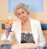 Senior woman with a glass of wine Royalty Free Stock Photos