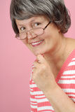 Senior woman in glasses Stock Image